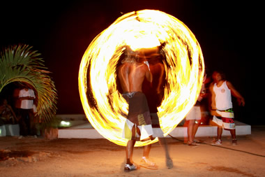 The nightly street fire dance in front of the Mancora bars ights up the night sky.