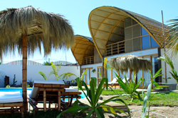 Kites Mancora has plenty of palm thatched umbrellas for lounging by the pool