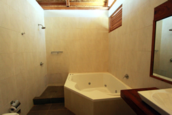 The Sun house has built in jacuzzi bath to relax in at the end of a long day surfing