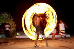 The nightly fire dance in front of the Mancora bars ights up the night sky
